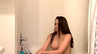 Spy On Brunette Shaving Her Pussy and Legs