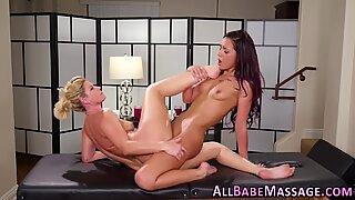 Massaged oiled up lesbian gets fingered