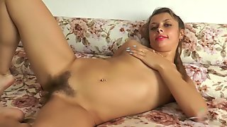 Olivia fingers her hairy pussy raw