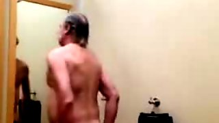 A daddy gets naked in a clothing store fitting room and plays with himself.