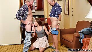 Busty babe sucking two grandpas dicks
